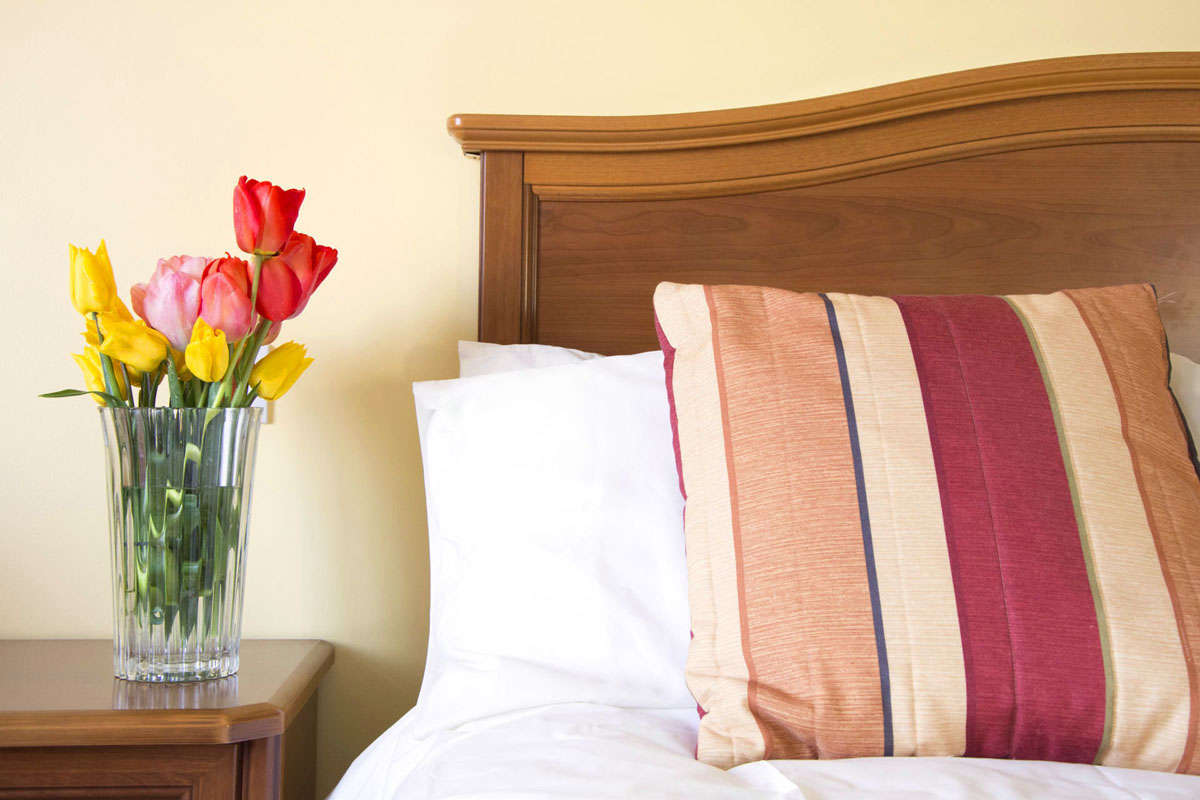 Fresh Flowers by the Bed | Your Accommodations| Double Room